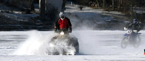 4 wheeler crossing frozen lake
